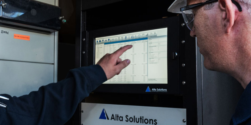 Alta Solutions Employees with Installed AS-7000 Machinery Protection System
